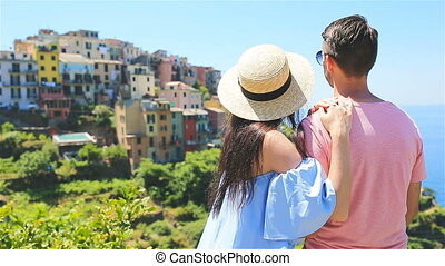 Happy family with view of the old coastal town background of Corniglia, Cinque Terre national park, Liguria, Italy ,Europe