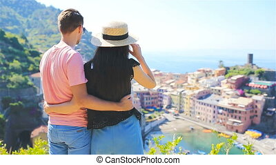 Happy family with view of the old coastal town background of Vernazza, Cinque Terre national park, Liguria, Italy ,Europe