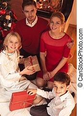 Happy family with xmas presents