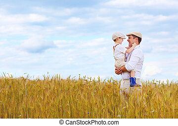 happy farmer family on wheat field