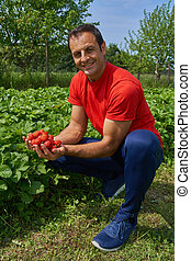 Happy farmer with strawberries