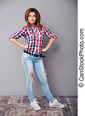 Happy fashion woman standing in studio