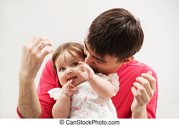 Happy father and baby girl at home