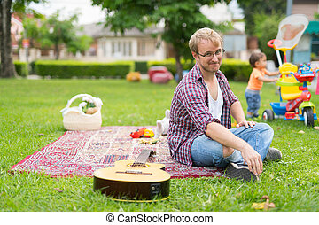 Happy father and baby son bonding together outdoors