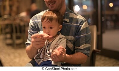 Happy father and baby son bonding together