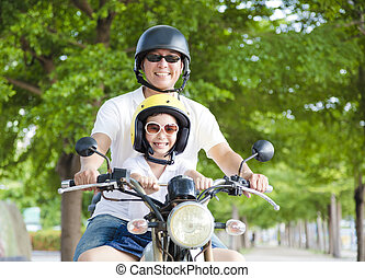 happy Father and daughter traveling on motorcycle