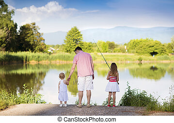 Happy father and daughters fishing - Happy young father ...