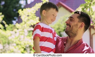 happy father and little boy outdoors - family, childhood and...