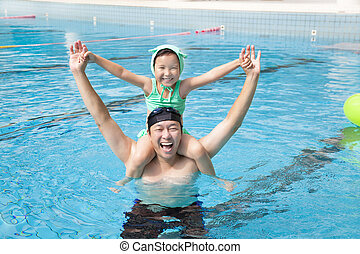 happy father and little girl in the swimming pool