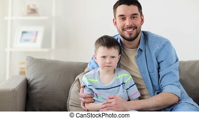 happy father and little son hugging at home