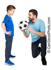 Happy father and son playing soccer isolated on white