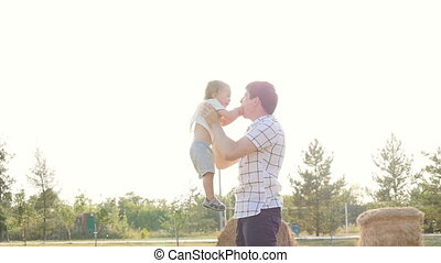 Happy father and son playing together having fun