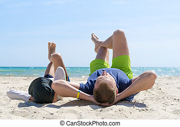 Happy father and son spend time together on the beach. Fatherhood Family Concept. Happy fathers day.