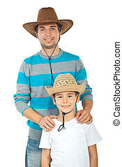 Happy father and son with hats