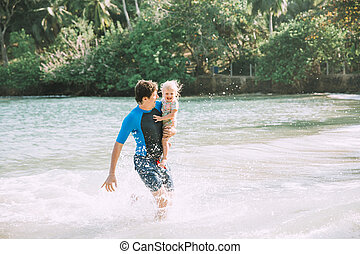 Happy Father Holding Cute Little Daughter Tropical Beach
