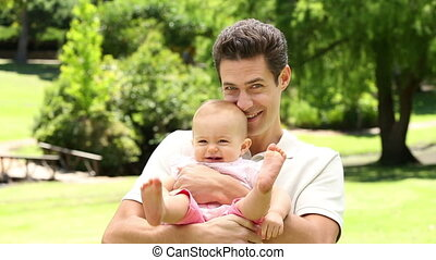 Happy father holding his baby girl - Happy father holding...