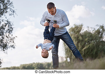 happy father playing with his little son.