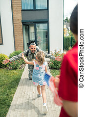Happy father returning home after half a year of service