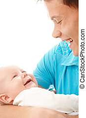 Happy father smile to his child