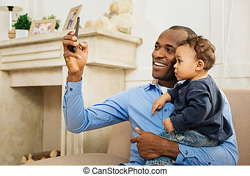 Happy father taking selfies with his kid