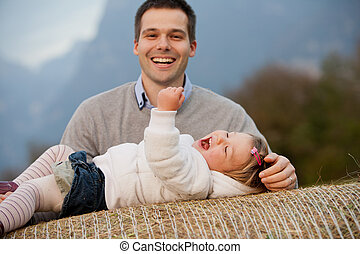 happy father with a playful daughter
