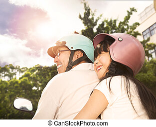 happy father with daughter on the bike