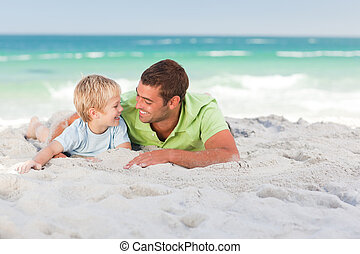 Happy father with his son at the beach