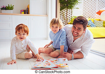 happy father with kids, sons having fun at home