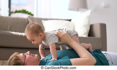 happy father with little baby boy playing at home - family,...