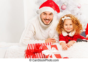 Happy father with little girl on Christmass