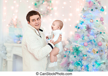 happy father with little son on Christmas background
