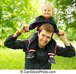 Happy father with little son outdoors
