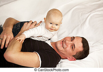 happy father with smiling baby girl