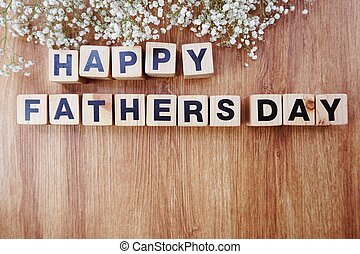 happy fathers day alphabet letters on wooden background