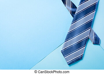 """Happy Fathers Day background concept with blue necktie and the text """" Happy Father's Day""""  on bright pastel background."""
