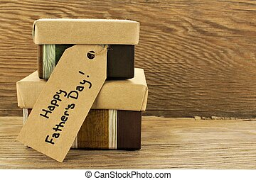Happy Fathers Day - Fathers Day gifts with tag on a wooden...