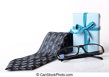 Happy fathers day - Gift box, necktie and glasses with space...