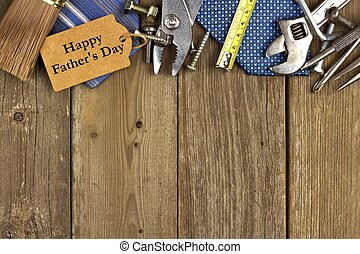 Happy Fathers Day gift tag with top border of tools and ties on a rustic wood background