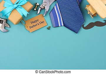 Happy Fathers Day gift tag with top border on a blue background