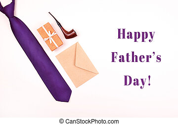 Happy Father's day greeting card with composition of violet neck tie, gift box with ,craft paper envelope and smoking tobacco pipe with inscription Happy Father's day.