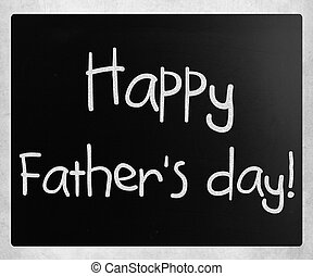 """""""Happy father's day"""" handwritten with white chalk on a blackboard"""