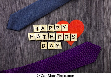 Happy Fathers Day message on a wooden background with frame of ties.