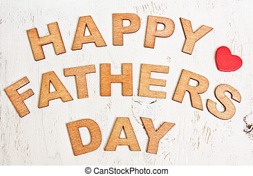Happy Fathers Day with wooden letters on an old white background