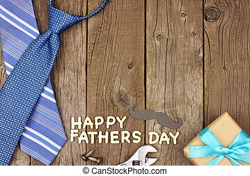 Happy Fathers Day wood letters with tools and ties on rustic wood