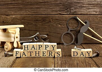 Happy Fathers Day wooden blocks with decor against rustic wood