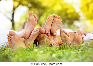 Happy feet - Happy young family spending time outdoor on a...
