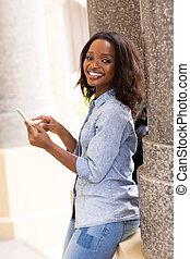 female african uni student using smart phone - happy female...