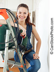 Happy  female builder
