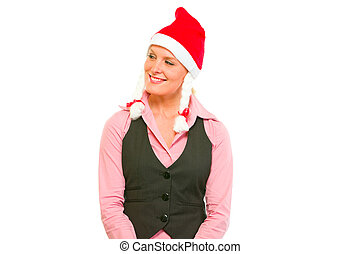 Happy female business secretary in Santa Hat looking in corner on copy space