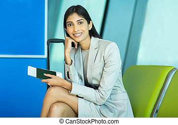 female business traveler sitting at airport